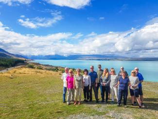 Group shot in front of Lake Pukaki