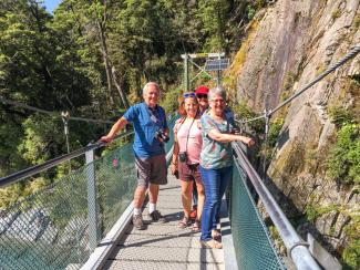MoaTrek guests Geoff & Jule Targett walking on the Blue Pools bridge