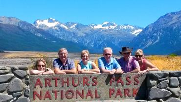 Group photo at the Arthurs Pass National Park sign - Arthurs Pass Tours