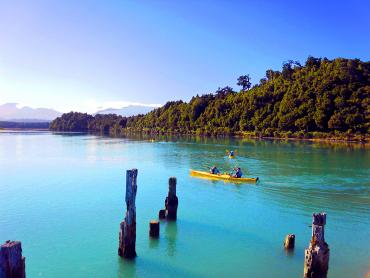 Kayaker on Okarito Lagoon - Boat trips and day cruises NZ