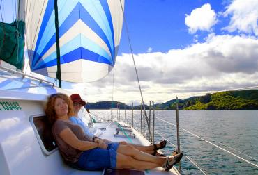 Relaxing on a sailboat on Lake Rotoiti - Boats and Day Cruises NZ