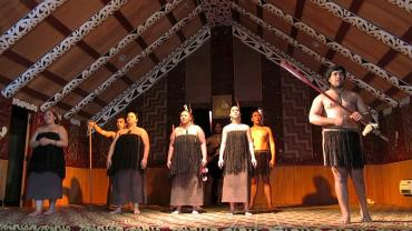 Maori performers in traditional meeting house - Maori Culture Tours NZ