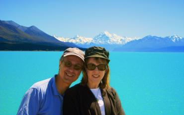 Happy couple at Lake Pukaki with Mt Cook in the distance - NZ North and South Island Itinerary