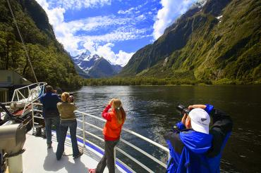 Taking photos on Milford Sound Cruise - NZ North and South Island Itinerary