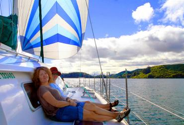 Relaxing on the yacht, sailing near Rotorua - NZ North Island Itinerary