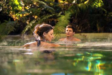 Relaxing in hot pools surrounded by rainforest in Franz Josef - Relaxing Tours of NZ