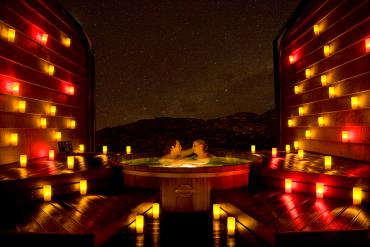 Private hot pool by candlelight - Relaxing Tours NZ