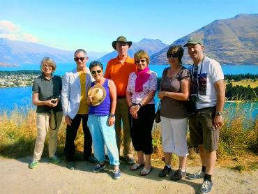 Photo with friends in Queenstown, lake and mountain scenery - NZ South Island Itinerary