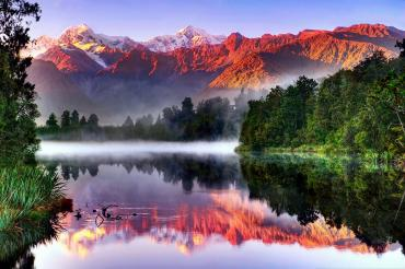 Colours of sunset on Mt Cook and Lake Matheson - Westland National Park Tours