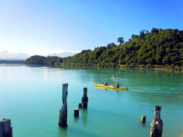 Kayaking on Okarito Lagoon, Mt Cook in the distance - Westland National Park Tours