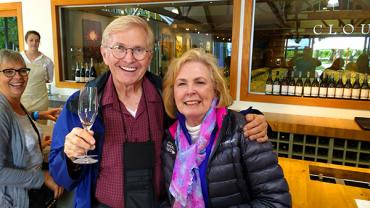Travellers enjoying wine tasting at Cloudy Bay Winery in Marlborough