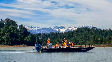 Nature Cruise on Okarito Lagoon, Southern Alps in background