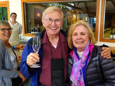 Couple enjoying wine tasting at Cloudy Bay in Marlborough